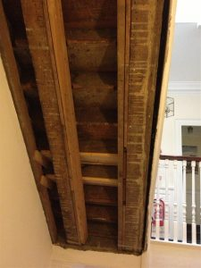 Stairway stripped of plaster to reveal problem