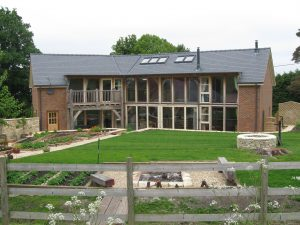 Panoramic exterior view of the finished oak framed house at Purton Stoke